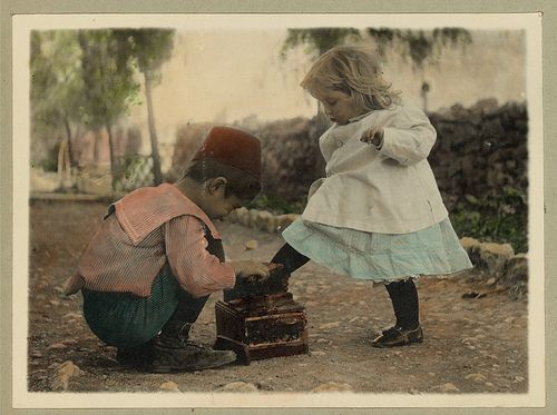 Vintage Picture of Two Children, A Cute Boy giving a Shoe Shine to a Beautiful Little Blonde Girl by Beverly & Pack, via Flickr