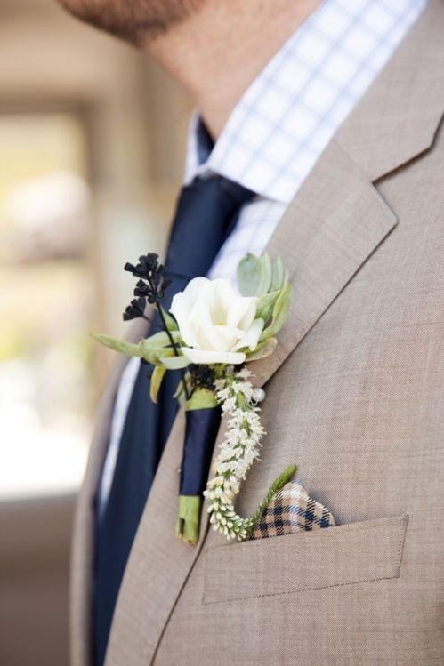groom.. sand, texture suit, white or blue print shirt, pocket square, similar boutonniere, minus the amaranthus squiggle