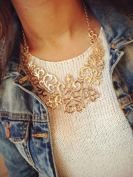Lacy necklace over light sweater with denim jeans jacket.