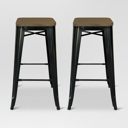 Rustic meets industrial with this Hampden Industrial Wood Top Metal Barstool from Threshold™. The perfect seating for a modern loft or city-chic apartment, the two-piece barstool set brings unique style to your space. The sturdy metal legs subtly flare out at the bottom, while the seat is constructed with a wooden top. These stools lend an industrial vibe with a rustic touch and are the perfect height for your kitchen island or bar.