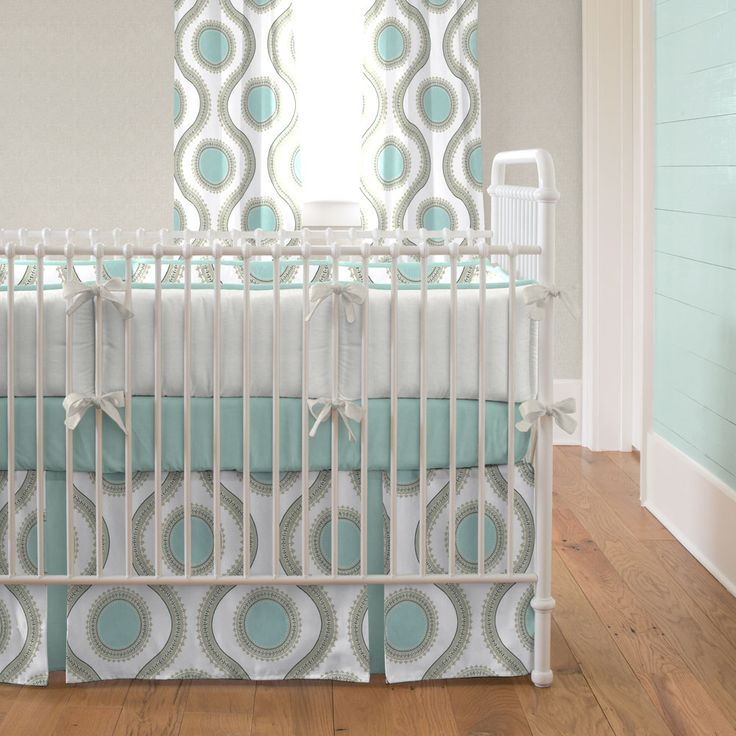 Aqua and Taupe Modern Dot Crib Bedding from Carousel Designs.  Modern lines and elements create this unique baby bedding collection. Soft and tranquil shades of seafoam aqua and taupe allow for endless possibilities in your nursery decor.