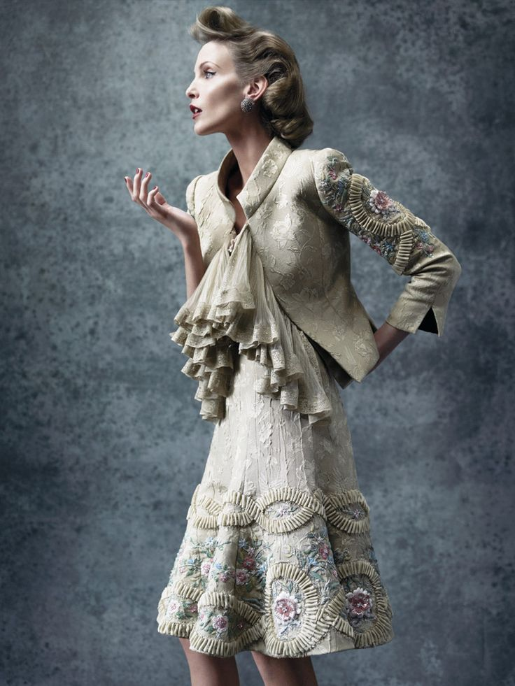 (Valentino) The swing of the skirt and the shoulders add great shape to a straight column.