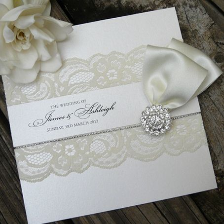 Lace, ribbon and brooch invite by Lush Invitations