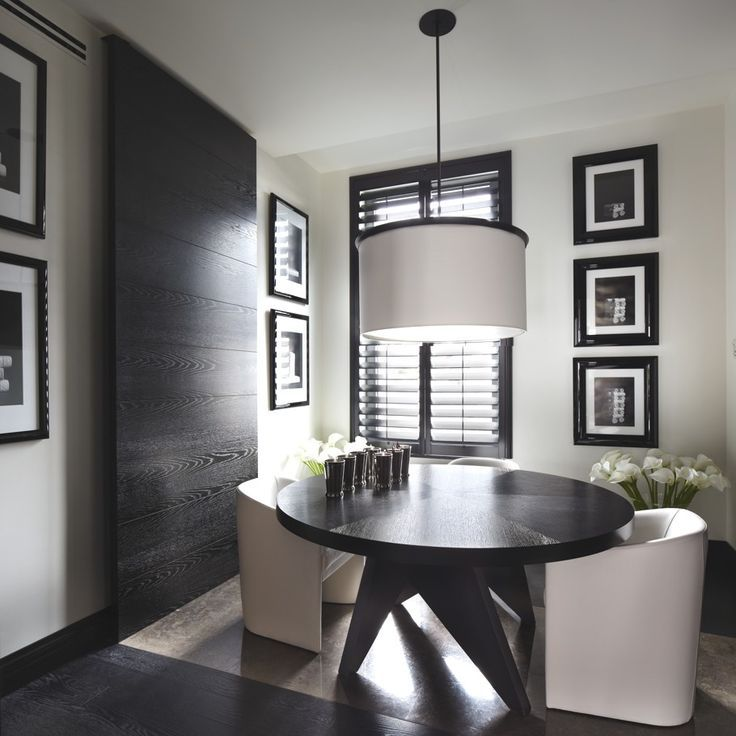 Dining Room Designs   Contemporary design with a black round table and white chairs. In a room with a black wood panel that creates an amazing sense of design   Visit us at http://moderndiningtables.net/   #kellyhoppen #modernfurniture #moderndesign #interiordesign #moderndiningtable #diningtable #diningroomsets #minimalistdesign #contemporarydesign #whitedesign #whitechairs #roundtable #simpledesign #woodwall