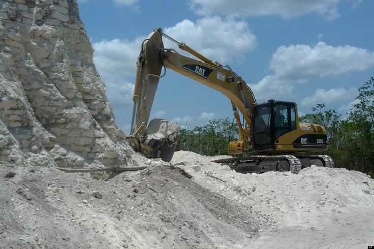 Nohmul Pyramid Bulldozed In Belize For Rocks - A construction company has essentially destroyed one of Belize's largest Mayan pyramids with backhoes and bulldozers to extract crushed rock for a road-building project, authorities announced on Monday.