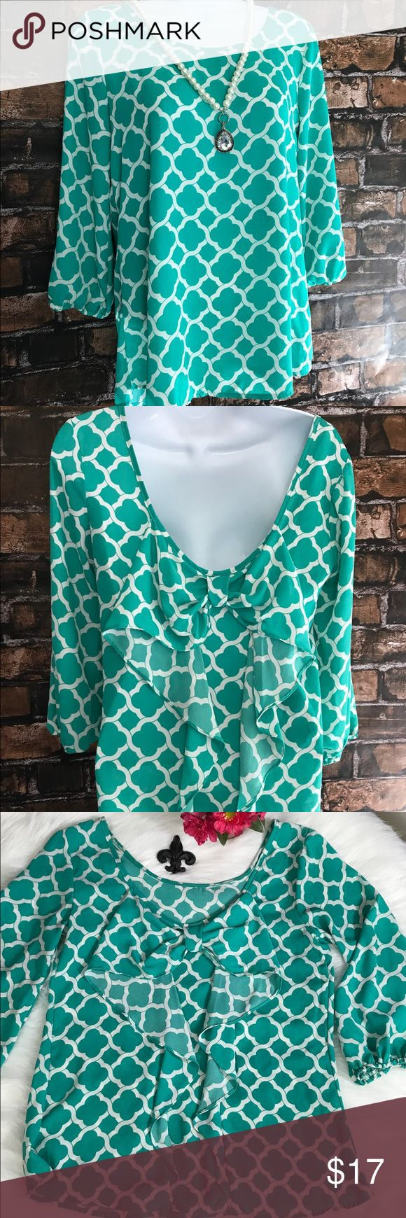 Mm Mm Mm dress top Beautiful green/white print, flowing blouse has deep back with bow and ruffles. Perfect for Spring & summer! Can be dressed up or down! *please note in last pic with tape measure, looks like some of the stitching on the back of the arm has been pulled slightly. Tops Blouses