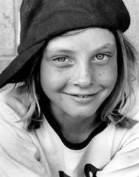 """Do you recognize this freckled face cute little girl before she became famous?  Well it is Jodie Foster is an American actress, film director, and producer. Foster began acting in commercials at the age of three, and rose to prominence at the age of 13 in the 1976 film Taxi Driver as the ... Born: November 19, 1962 (age 50), Los Angeles, CA Height: 5' 3"""" (1.61 m)"""