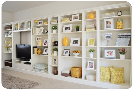 Cheap and chic design....Faux built in bookcases with Ikea's Billy Bookcase.     http://www.ikeahackers.net/2012/01/billy-bookcases-to-built-ins.html