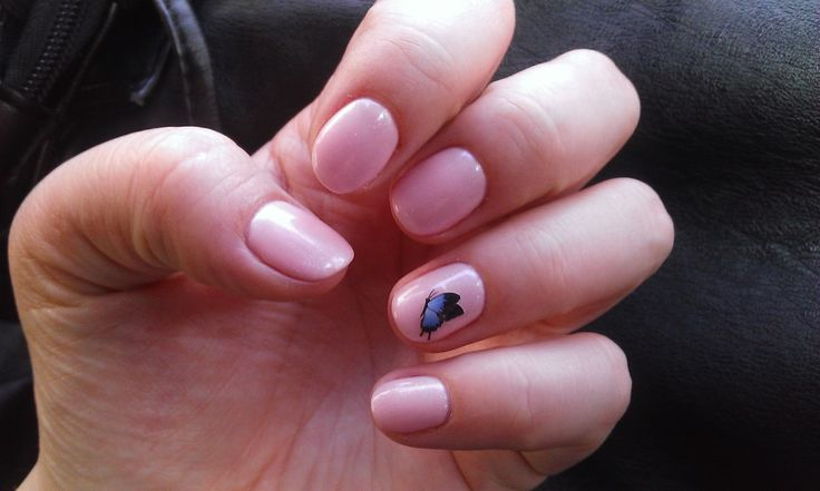 Pink semiperm nail polish with a butterfly