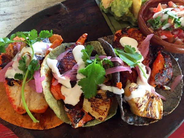 Eat at La Zebra Mexican Cantina, a beach front hotel-restaurant, and order the fish tacos (they're the best in Tulum). They're topped with cabbage, jicama, radishes, cilantro and avocado, and are served with various chile sauces on the side.