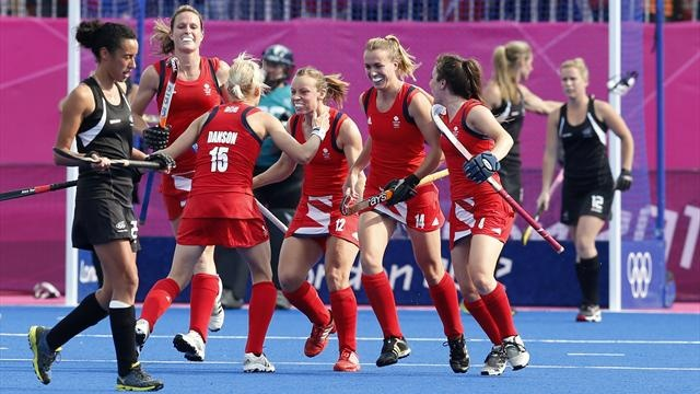 New Zealand's team players react as Great Britain's Alex Danson (3rd L) with theam mates celebrates her scoring a goal during their women's bronze medal hockey match at the Riverbank Arena at the London 2012 Olympic Games August 10, 2012