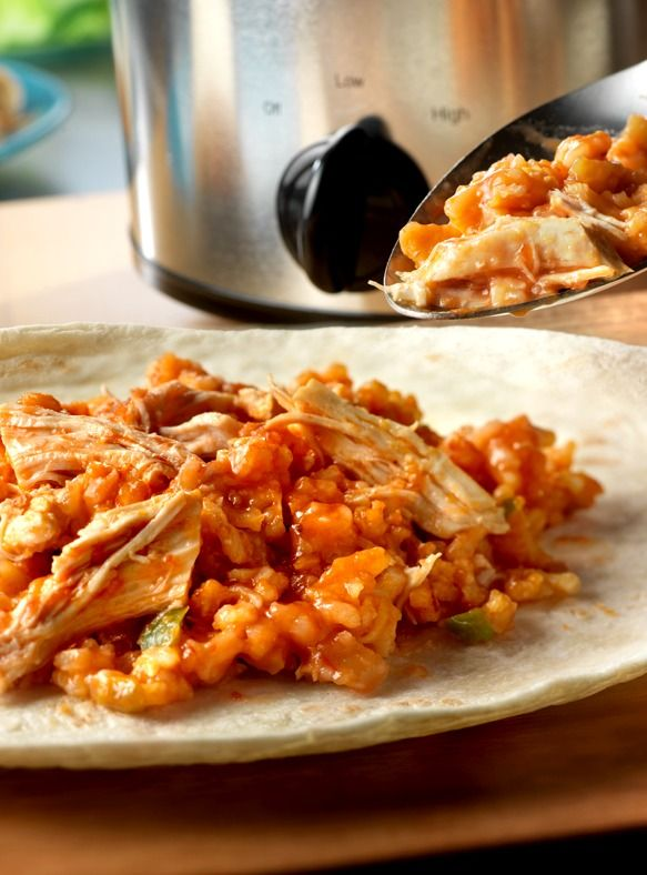 Slow Cooker Mexican Chicken & Rice Wraps – The cheesy chicken and rice filling has just the right amount of spice to make this a true family favorite dinner recipe.
