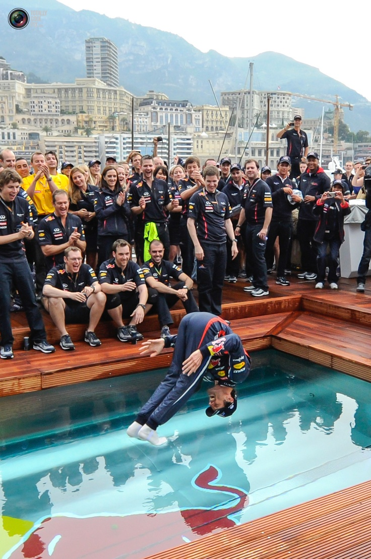 #RedBull's #F1 Formula One driver #MarkWebber of #Australia celebrates his victory at a pool after the finish of the #Monaco F1 #GrandPrix http://VIPsAccess.com/luxury/hotel/tickets-package/monaco-grand-prix.html