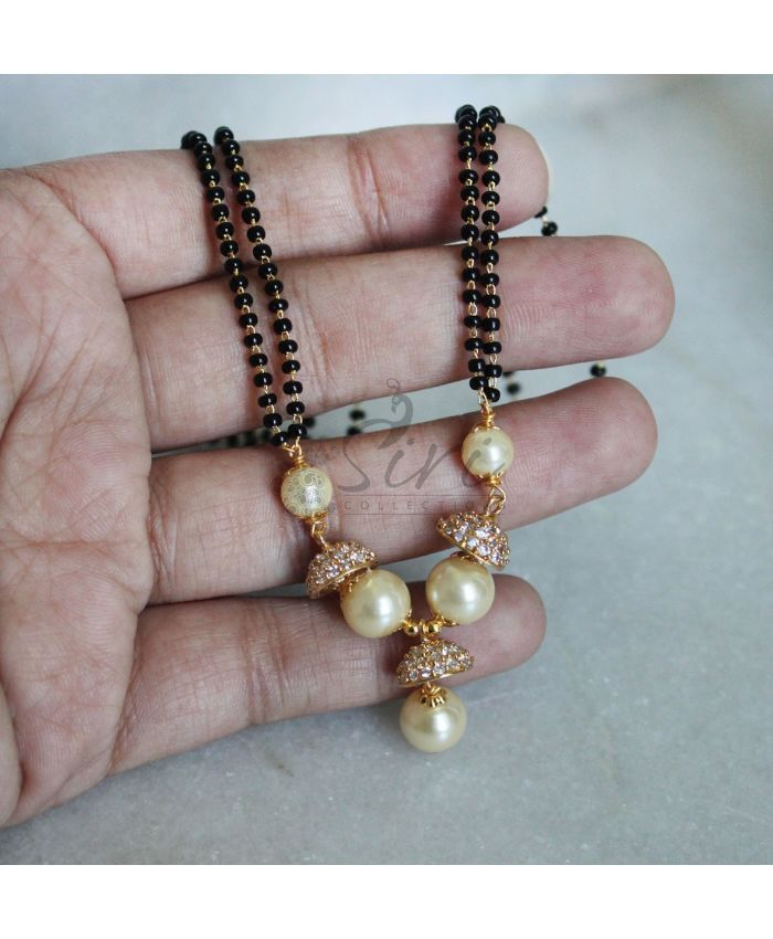 Black beads mangalsutra in AD caps pearls