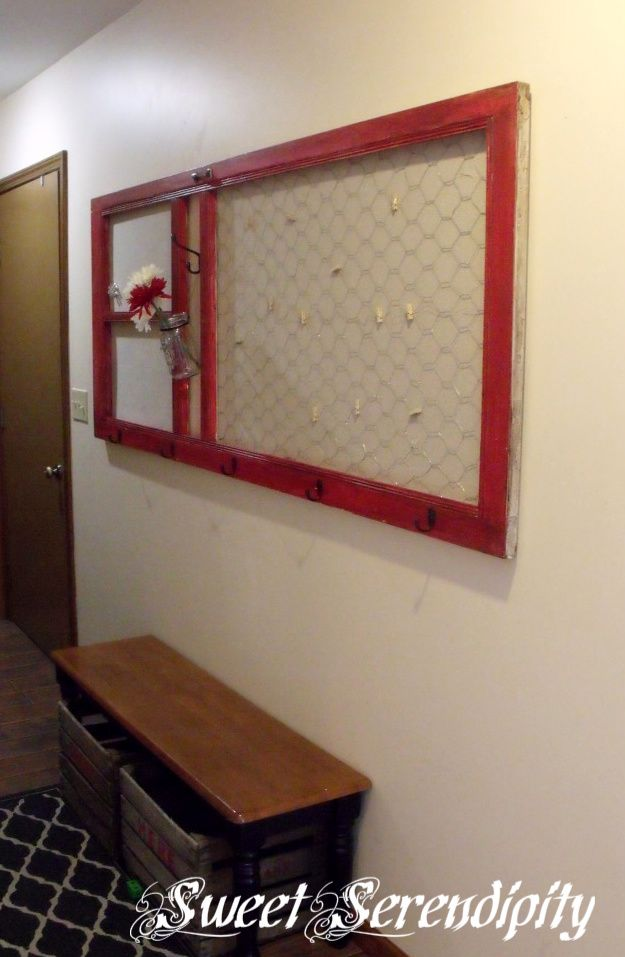 Super creative for an old door.  Message board with chicken wire and small clothes pins.  Cork board on the far left, and hooks in the center.  All backed with metal so you can use magnets too.