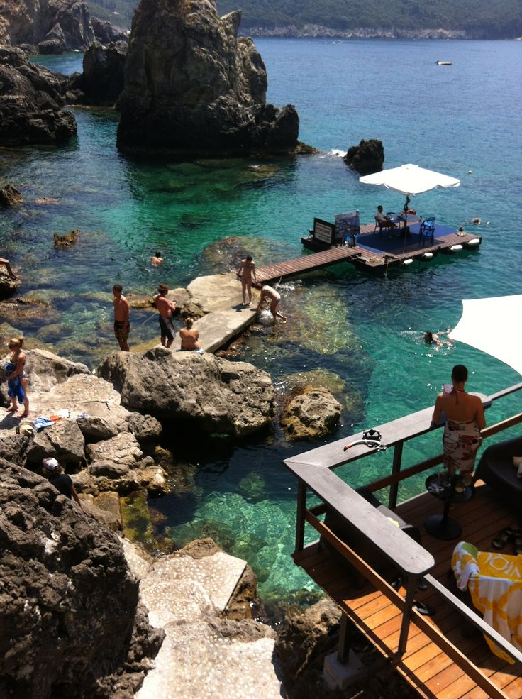 La Grotta Paleokastritsas Corfu Greece. Super swimming, beautiful rocky beach with wooden terraces on different levels above the crystal clear water, good food drinks and music!