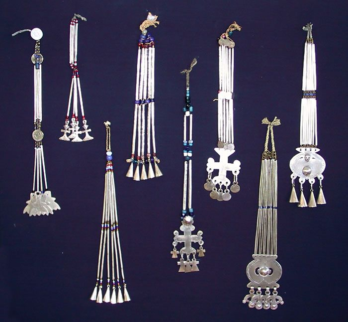 From the exhibition Araucania (Chile) to the Pampas | Various 'Lloi-lloi' ~ pectorals/ clock pins. Silver and glass beads.