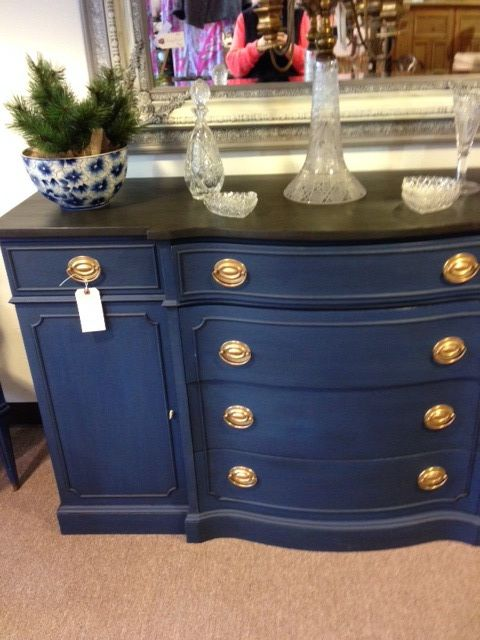 Lovely painted buffet found in antique store today.   Dark, almost navy, blue (darker than the photo) felt like chalk paint, and top was a dark, almost black, rubbed on stain or paint/stain combo.   Inside reveals it is an old mahogany dresser or buffet.   Picture doesn't do it justice, actual item would make quite a room statement