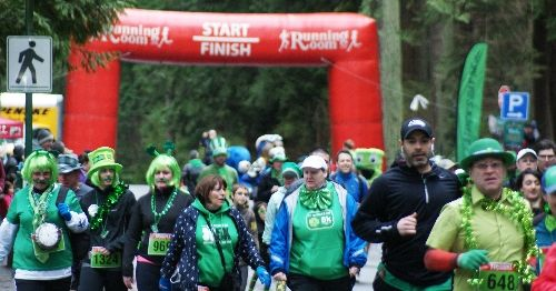 People in green costumes at the St. Patrick's Day 5K Run at Stanley Park