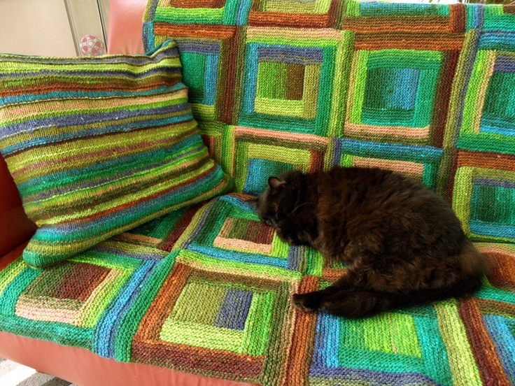 Noro blanket and left over pillow cover ( with a bit of tweed added )