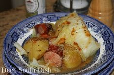 Braised Kielbasa and Cabbage from Deep South Dish blog. Kielbasa sausage, braised with cabbage, onions and potatoes in chicken broth.