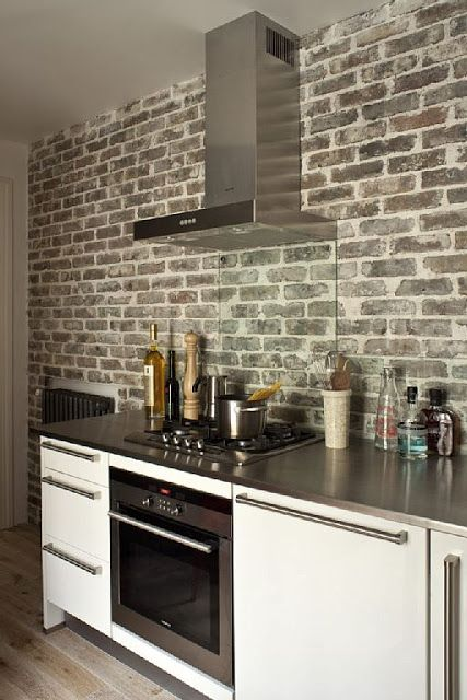 Paris apartment modern kitchen brick wall