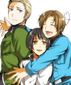 "Germany looks so reluctantly happy....like ""i don't like hugs but you guys are too damn cute.."""