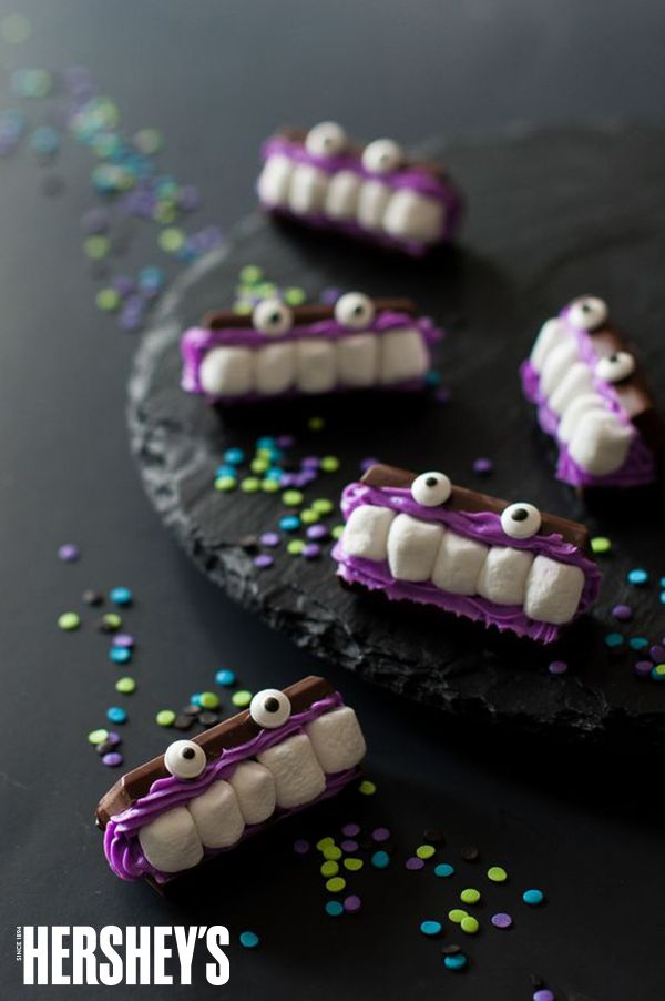 """These Bite-Size Marshmallow Monsters by Handmade Charlotte are a perfect """"BITE"""" sized snack this Halloween. Add this to your party and it's sure to be a 'monster' favorite!"""