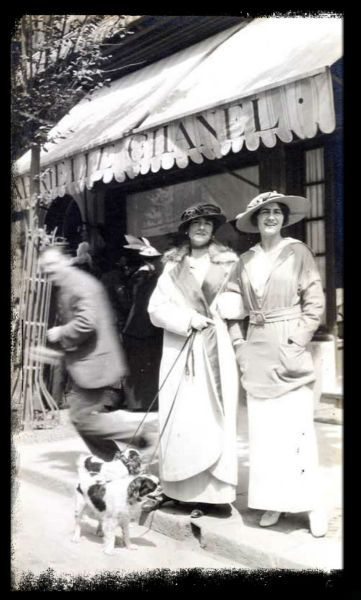 Coco Chanel, Deauville in front of first Chanel store, 1913--- I'm probably the only person who notices the dogs in the shot