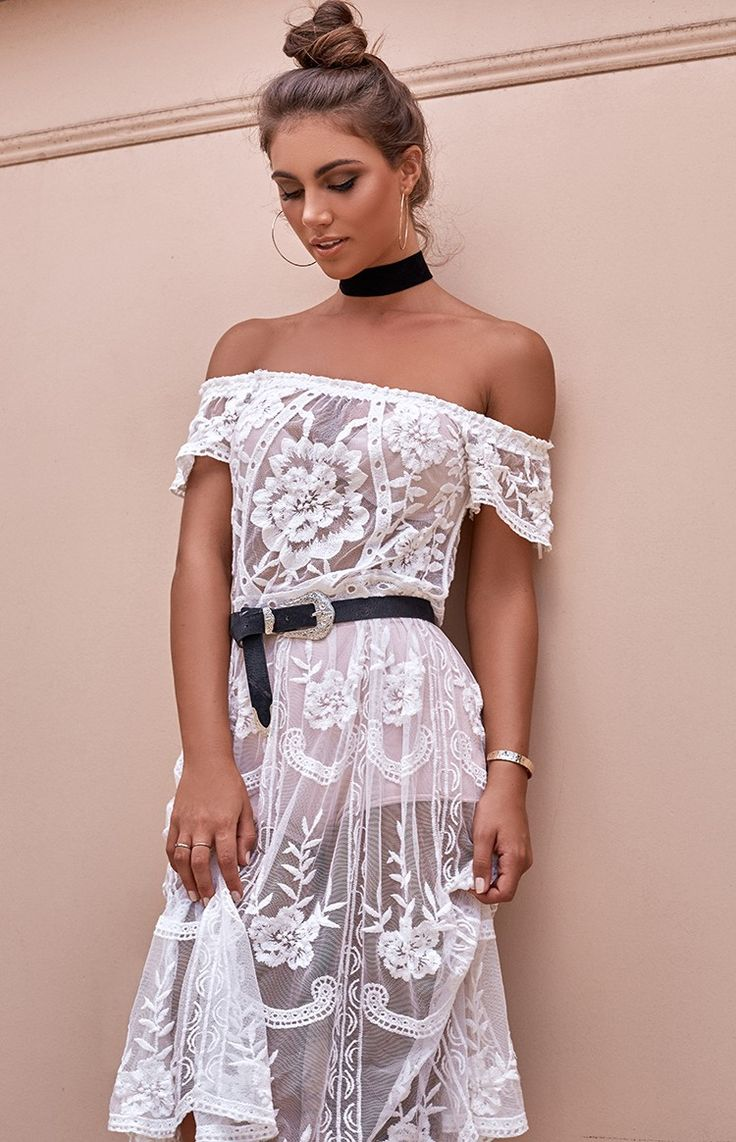 Be a bohemian goddess by the beach or at drinks this summer in the Esmeralda Lace Dress in White! Its sheer mesh material features floral and mosaic embroidery, and is finished off with an elasticated off the shoulder hemline with short sleeves to give a bohemian luxe look!  Pair this babein piece over some nude shorts with a lace bra, choker, floppy hat and black boots to add a grungy edge amongst the soft lace for a kicka$$ summer look!  FABRICATION: 100% Polyester   SIZE & FIT: Measure...