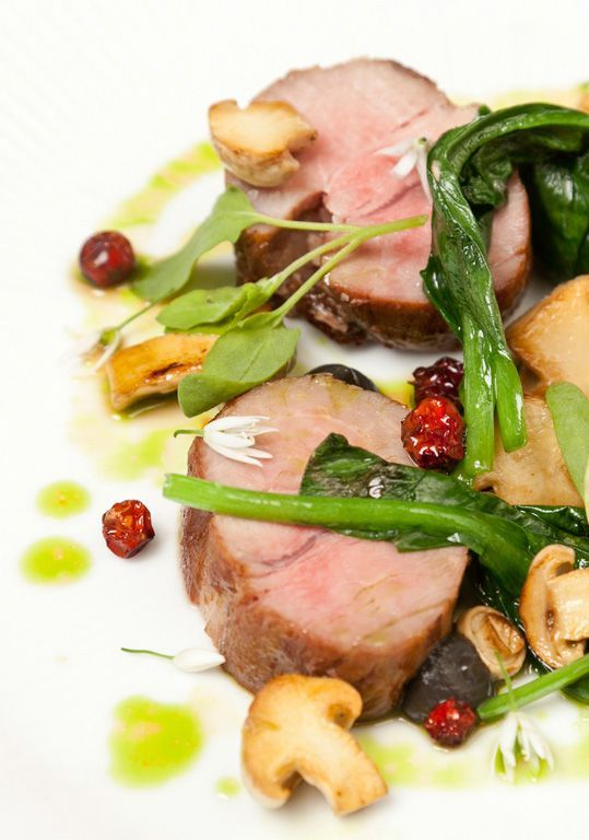 Salted pork neck, dried berries, wild mushrooms and wild garlic - Christoffer Hruskova. Christoffer Hruskova garnishes this pork dish with all sorts of obscure wild herbs, mushrooms and berries.