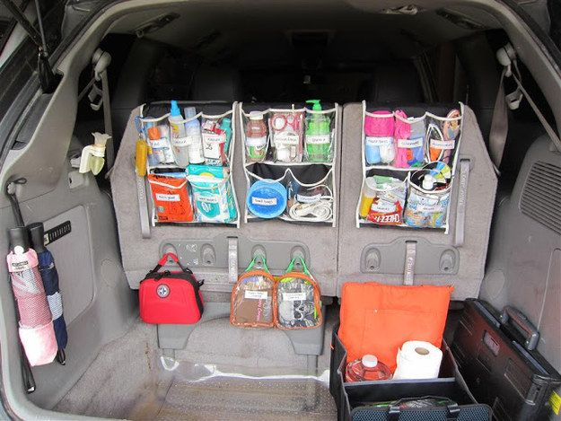 Hang over-the-door organizers in your trunk to create a fully stocked car command center.