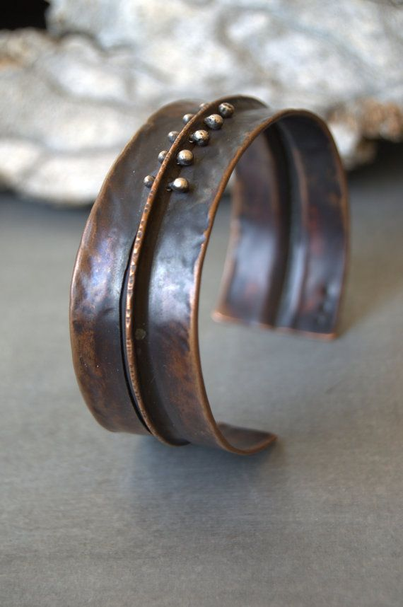 be warned: I am on a cuff craze right now...    copper is folded and textured, with sterling silver rivets added for contrast. heavily oxidized