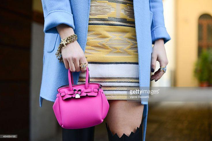 Silvia Torassa poses wearing PAROSH coat Zara skirt and Save My Bag purse during Milan Fashion Week on February 27, 2015 in Milan, Italy.