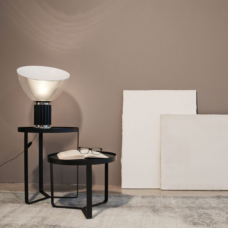 POSATO is a handy powder painted black matt iron coffee table that comes with a useful removable wooden tray painted with a delicate but intense nuance