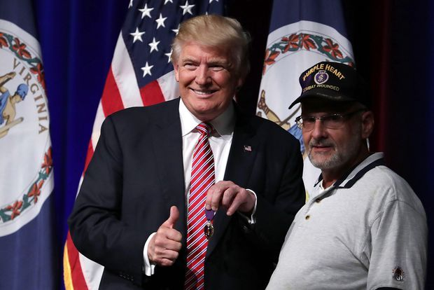 Trump: Cybersecurity should be a top priority     - CNET  Donald Trump greets veteran Louis Dorfman who gave Trump his Purple Heart during an August campaign event in Ashburn Virginia.                                             Alex Wong Getty Images                                          What would Donald Trump do about cybersecurity if elected president? His statements so far have been a little vague. Until now.   On Monday he gave some specifics on how hed approach protecting the…