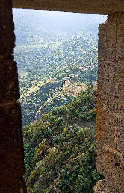 View from a Tatev window, Armenia. The Tatev Monastery is a 9th-century monastery located on a large basalt plateau near the Tatev village in Syunik Province in southeastern Armenia. Photo by whl.travel - (V)