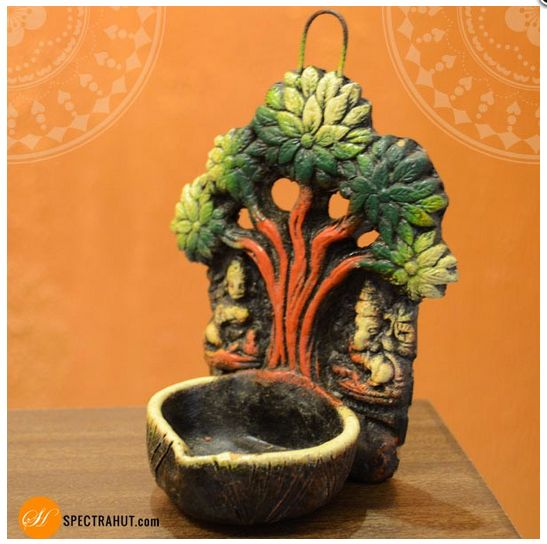 Light up your wall with this beautiful handcrafted terracotta wall hanging Diya. Perfect
