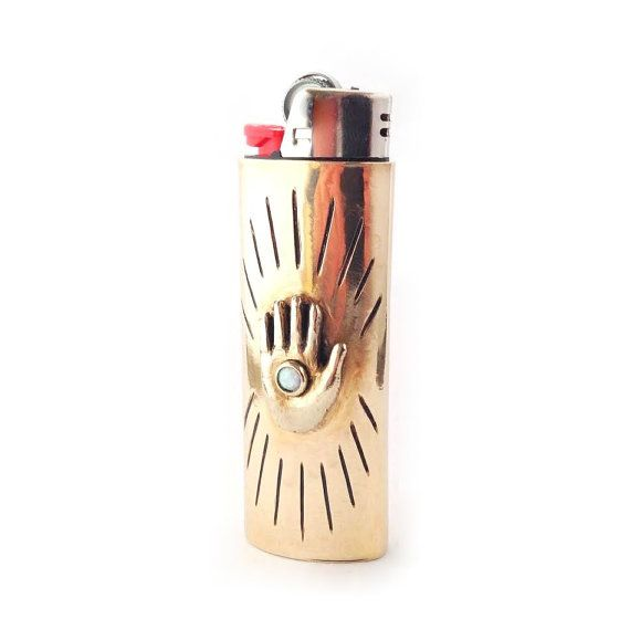 This unique lighter case was handmade using traditional metalsmithing techniques and the lost wax casting process. Made with brass sheet metal and a hand carved brass hand then set with a synthetic opal. Handmade in Chicago by Therese Kuempel, each piece is unique and one-of-a-kind.  Opal measures 4mm. Lighter case fits standard size BIC Lighters. Lighter not included.