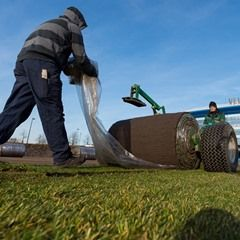 New turf is laid on the grounds of the Veltins Arena in Gelsenkirchen, Germany
