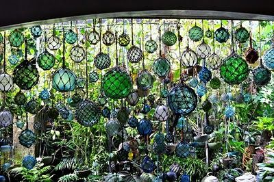 Collection of glass fishing floats in a window... so much more interesting than stained glass, and always unique