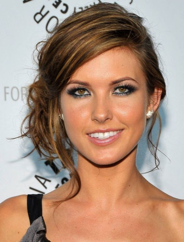 Audrina Padtrige cool faced green eyes woman with hair updo. Pretty pink lipssmile. One side naked shoulder dress