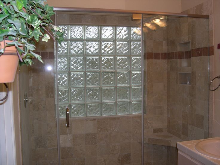 "6"" travertine shower with corner bench, double niche, glass block window, porcelain tile border"