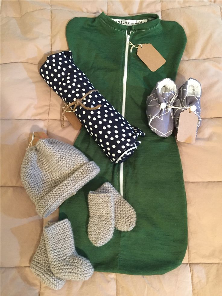 Newborn set, knitted woolen hat, booties and mittens. Cotton jersey wrap. Cotton quilted deer print slippers. Merino baby sleepy bean bag.