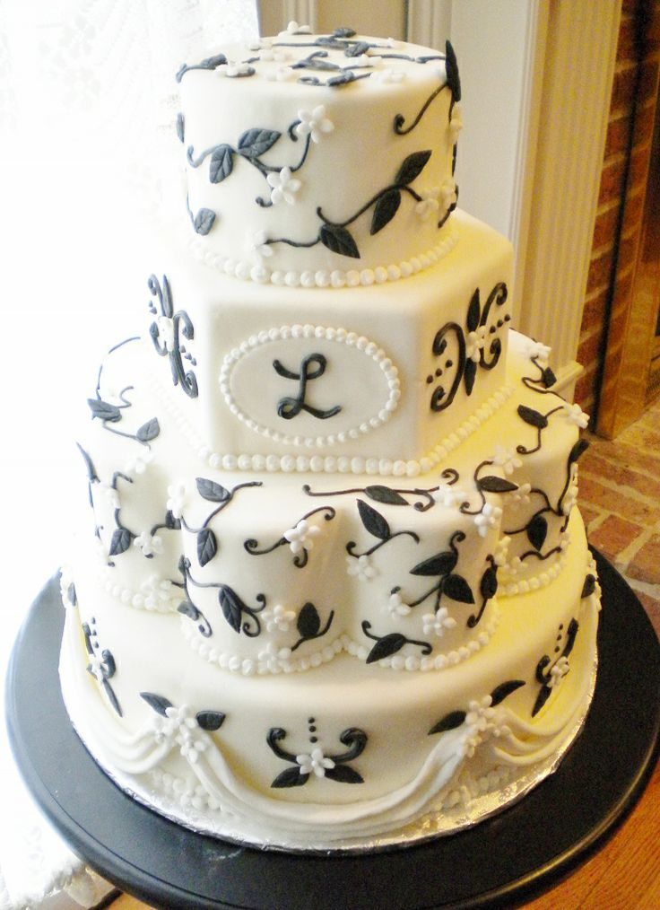 A mixture of shapes - round, hexagon and petal - make a one of a kind wedding cake design