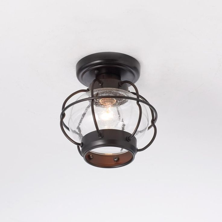 Nautical Onion Outdoor Ceiling Light From New England shingled cottages to colonial homes in the deep South, this caged glass flush mount ceiling light has eternal appeal. Oiled rubbed bronze finish with seeded onion glass globe.