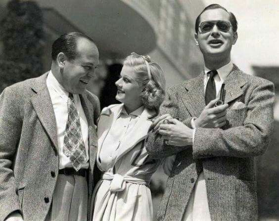 With Eddie Mannix (aka one of MGM'S fixers) and Robert Montgomery. Eddie Mannix was with Gable in Nevada after Carole Lombard's plane crash. He climbed to the crash site and identified Lombard's remains from the contours of her jaw and a little bit of unsinged blonde hair.