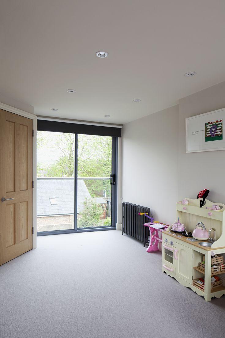 Rear dormer | Juliet balcony | Modern glass balustrade and sliding bedroom doors | Garden views | Brighton Architects