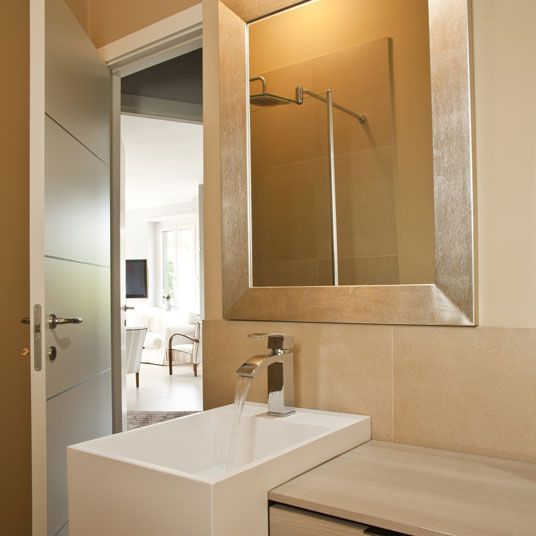 A Gold Silver Framed Mirror For The Bathroom