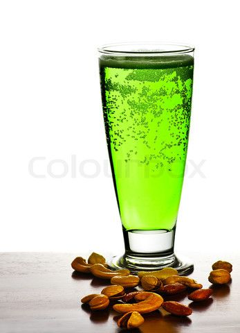 Irish green beer, traditional alcohol for stPatrick's day holiday celebration, lucky clover beverage, glass with